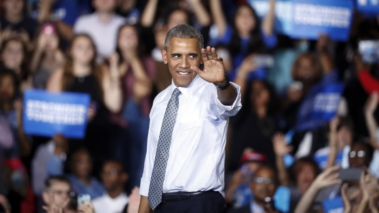 President Barack Obama waves to the crowd at a campaign event for Democratic presidential candidate Hillary Clinton at Capital University, Nov. 1, 2016, in Columbus, Ohio. (Photo by John Minchillo/AP)