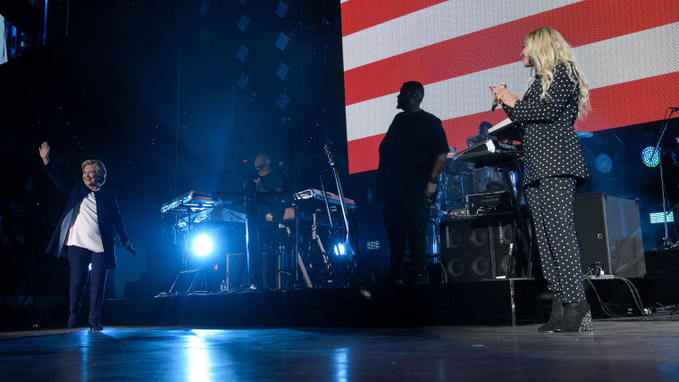 Beyonce watches as Democratic presidential nominee Hillary Clinton arrives during a performance in support of Democratic presidential nominee Hillary Clinton at the Wolstein Center, Nov. 4, 2016 in Cleveland, Ohio. (Photo by Brendan Smialowski/AFP/Getty)