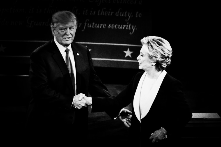Presidential nominees Donald Trump and Hillary Clinton shake hands at the close of the second presidential debate at Washington University in St. Louis, Mo., Oct. 9, 2016.