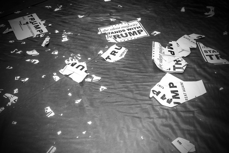 Ripped Donald Trump signs lay on the floor at a rally in Radford, Va., Feb. 29, 2016.