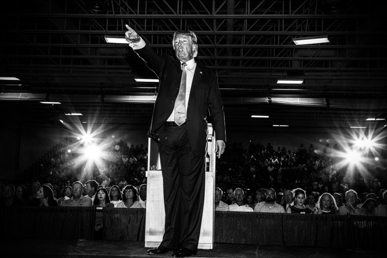 Republican presidential candidate Donald Trump gestures during a town hall event in Rochester, N.H., Sept. 17, 2015.
