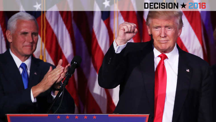 Republican president-elect Donald Trump acknowledges the crowd as Vice president-elect Mike Pence looks on during his election night event at the New York Hilton Midtown, Nov. 9, 2016. (Photo by Mark Wilson/Getty)