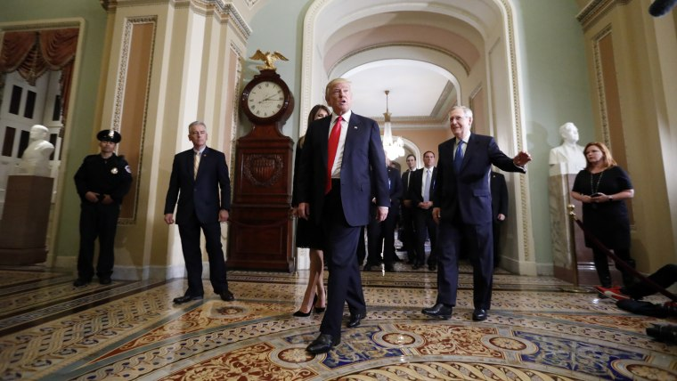 President-elect Donald Trump and his wife Melania Trump walk with Senate Majority Leader Mitch McConnell of Ky. on Capitol Hill, Nov. 10, 2016, in Washington, D.C. (Photo by Alex Brandon/AP)