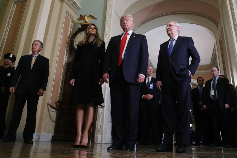 President-elect Donald Trump,  walks with his wife Melania Trump, and Senate Majority Leader Mitch McConnell after a meeting at the U.S. Capitol Nov. 10, 2016 in Washington, DC. (Photo by Mark Wilson/Getty)