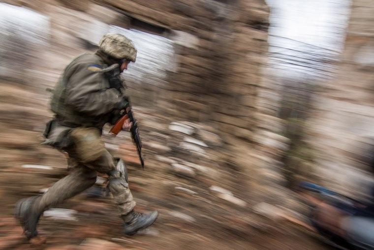 A Ukrainian serviceman runs as he patrols the area in Vodyanoe village, near Mariupol, Ukraine on  Nov. 10, 2016. (Photo by Sergey Vaganov/EPA)
