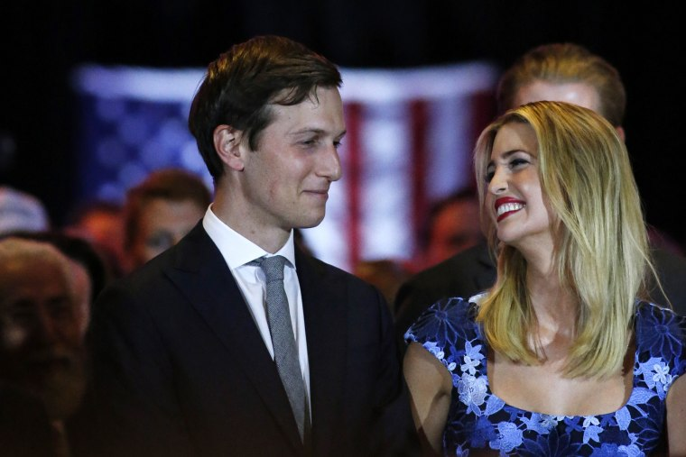 Ivanka Trump smiles at her her husband, Jared Kushner (L), as her father Republican presidential front runner Donald Trump speaks to supporters and the media on May 3, 2016 in New York, N.Y. (Photo by View press/Corbis/Getty)