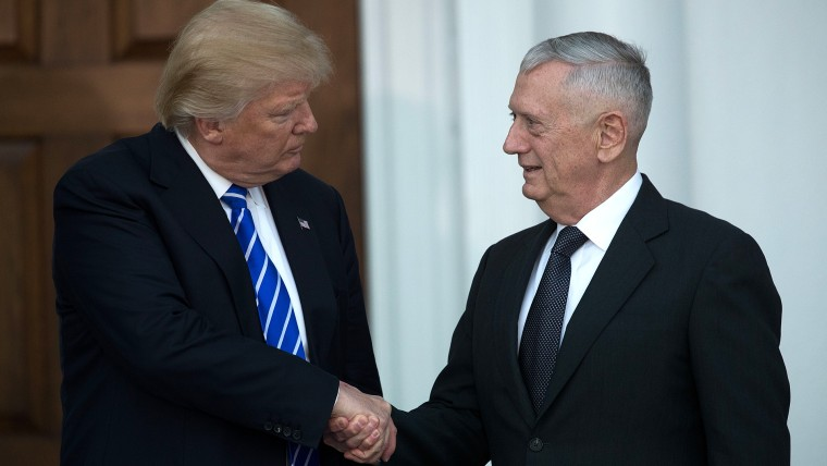 (L to R) President-elect Donald Trump shakes hands with retired United States Marine Corps general James Mattis after their meeting at Trump International Golf Club, Nov. 19, 2016 in Bedminster Township, N.J. (Photo by Drew Angerer/Getty)