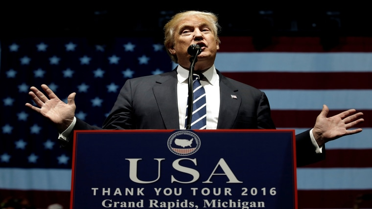 """Image: U.S. President-elect Donald Trump speaks at a \""""Thank You USA\"""" tour rally in Grand Rapids"""