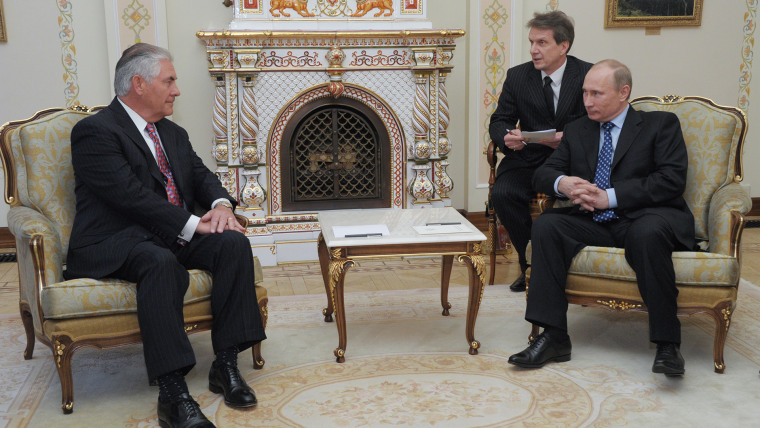 Russian Prime Minister Vladimir Putin, right, listens to Rex W. Tillerson, chairman and chief executive officer of Exxon Mobil Corporation at their meeting outside Moscow, April 16, 2012. (Alexei Nikolsky/Government Press Service/RIA-Novosti/AP)