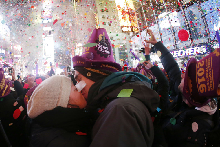 A couple kisses while ringing in the new year at Times Square, Jan. 1, 2016, in New York. (Photo by Julio Cortez/AP)