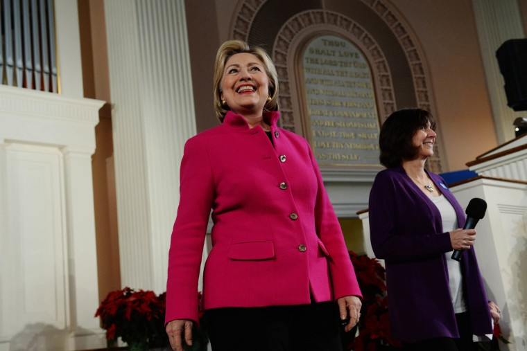 Democratic Presidential candidate Hillary Clinton listens as she is introduced at South Church Dec. 29, 2015 in Portsmouth, N.H. (Photo by Darren McCollester/Getty)