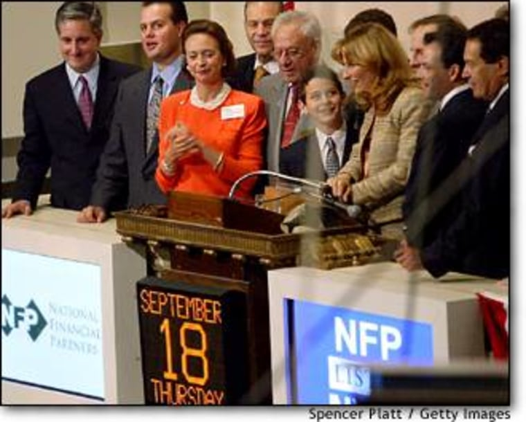 NYSE co-president Catherine Kinney, in red, hosts the opening bell ceremony Thursday, one day after the resignation of her boss, Chairman Dick Grasso.
