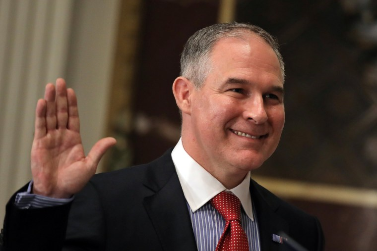 Image: Director of Environmental Protection Agency Scott Pruitt is sworn in by Justice Samuel Alito (not pictured) at the Executive Office in Washington