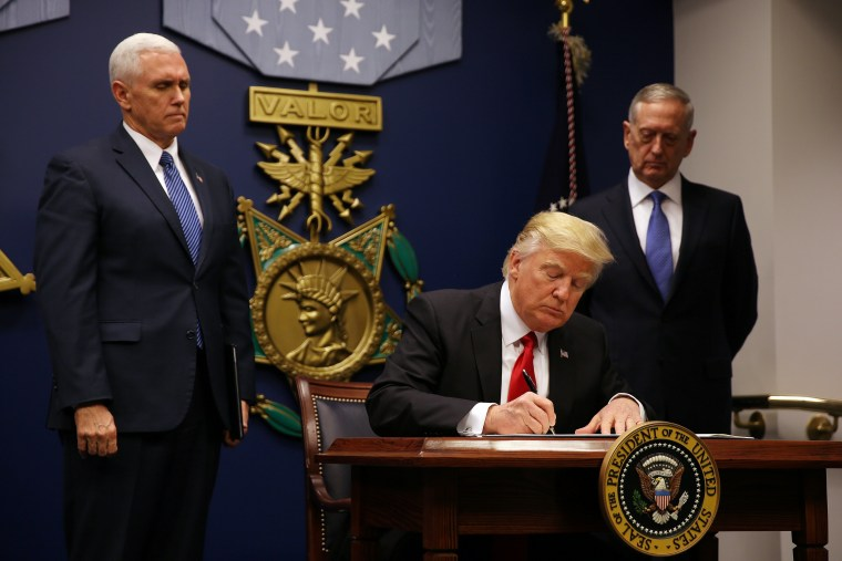 Image: U.S. President Donald Trump signs a revised executive order for a U.S. travel ban on Monday, leaving Iraq off the list of targeted countries at the Pentagon in Washington, U.S.