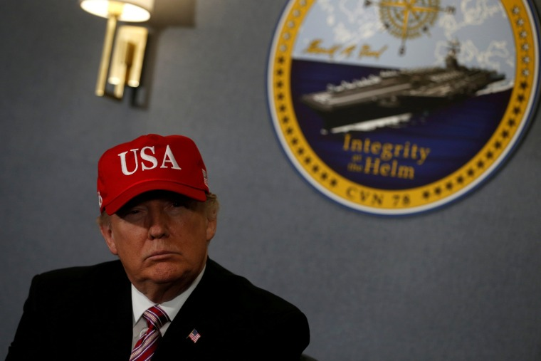 Image: FILE PHOTO - Donald Trump gets a briefing before he tours the pre-commissioned U.S. Navy aircraft carrier Gerald R. Ford in Newport News Virginia