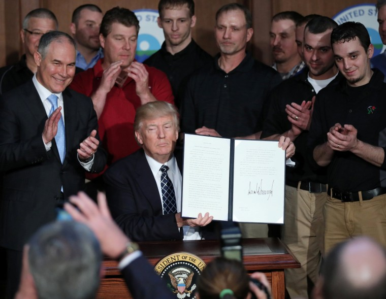"Image: U.S. President Trump displays executive order on ""energy independence"" during event at EPA headquarters in Washington"