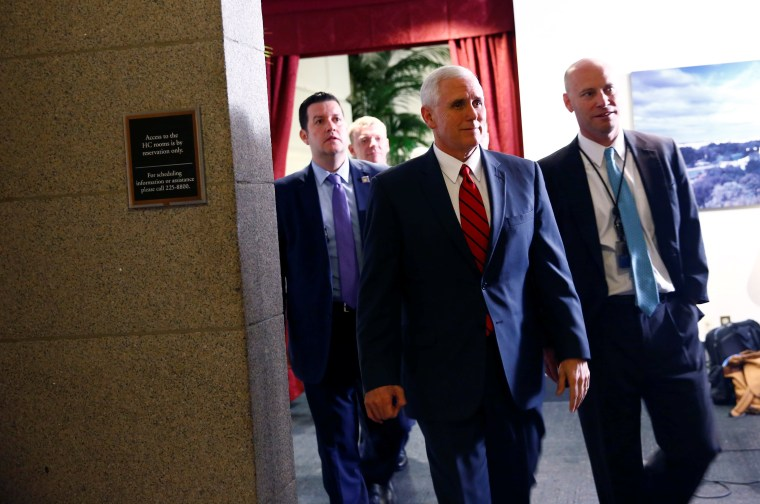 Image: U.S. Vice President Mike Pence departs a healthcare meeting at the U.S. Capitol in Washington