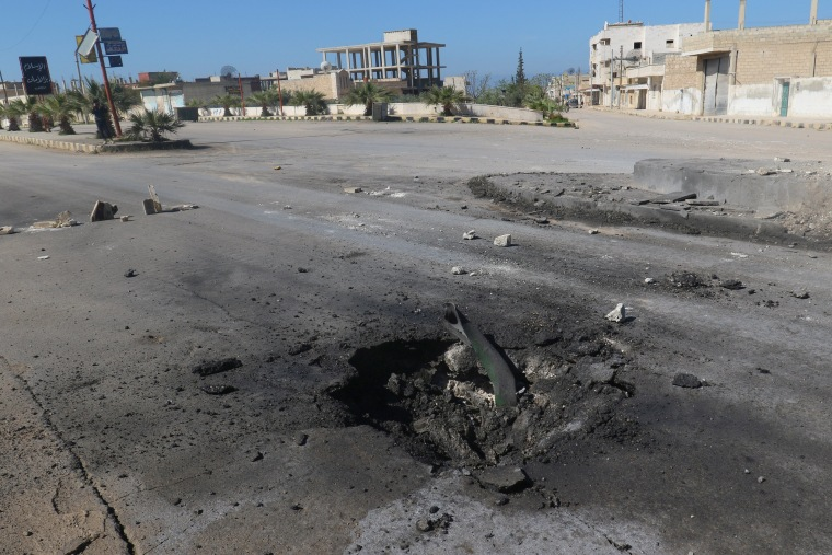 Image: A crater is seen at the site of an airstrike, after what rescue workers described as a suspected gas attack in the town of Khan Sheikhoun in rebel-held Idlib