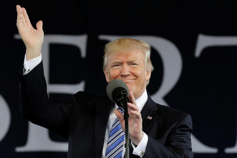 Image: President Donald Trump waves before delivering keynote address