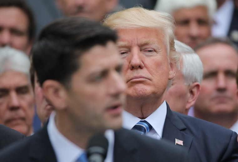 Image: U.S. President Trump listens to  Speaker Ryan as he gathers with Republican House members after healthcare bill vote at the White House in Washington