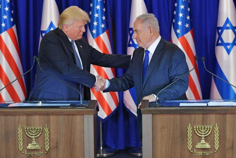 Image: US President Donald Trump (L) and Israel's Prime Minister Benjamin Netanyahu shake hands after delivering press statements