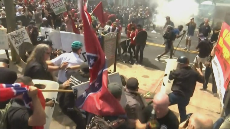 White nationalists and counter-protesters clash during Unite the Right rally in Charlottesville, Virginia on August 12, 2017.