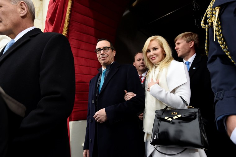 Image: FILE PHOTO: US Treasury Secretary nominee Mnuchin and  Linton arrive for the Presidential Inauguration of Donald Trump at the US Capitol