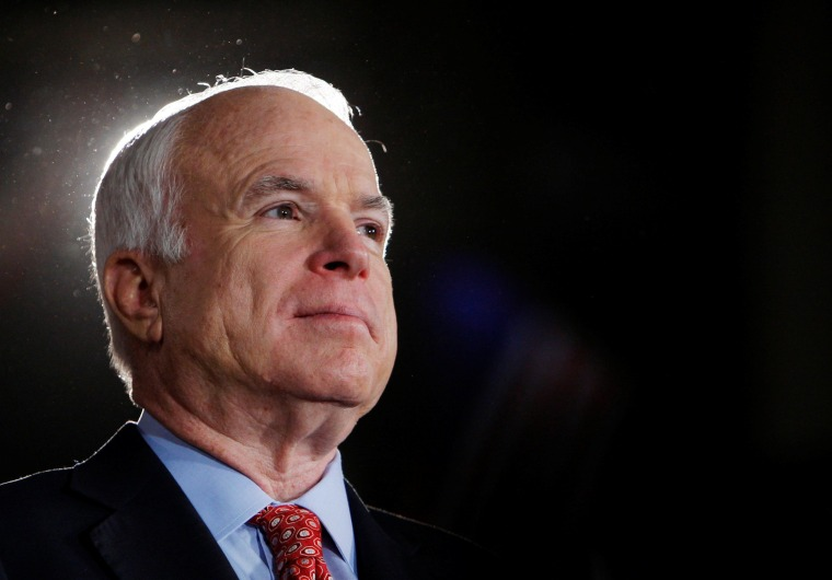 Image: FILE PHOTO -  U.S. Republican presidential nominee Senator John McCain (R-AZ) listens during rally in Denver