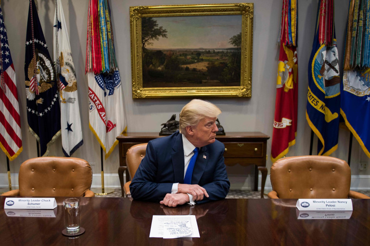 U.S. President Donald Trump makes a statement from the Roosevelt Room next to the empty chairs of Senate Minority Leader Chuck Schumer (L), D-New York, and House Minority Leader Nancy Pelosi (R), D-California, after they cancelled their meeting at the Whi