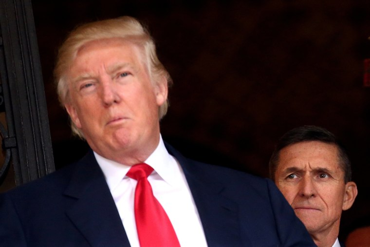 Image: FILE PHOTO: U.S. Army Lieutenant General Michael Flynn looking at U.S. President-elect Donald Trump in Palm Beach, Florida