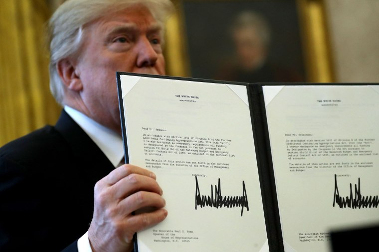 Image: Donald Trump Signs Tax Reform And Jobs Bill Into Law At The White House