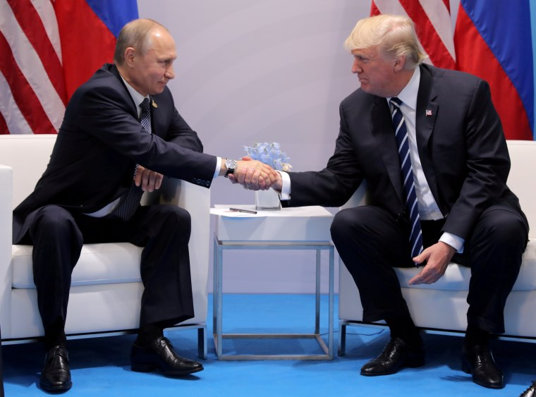 Image: FILE PHOTO: U.S. President Donald Trump shakes hands with Russia's President Vladimir Putin during the their bilateral meeting at the G20 summit in Hamburg