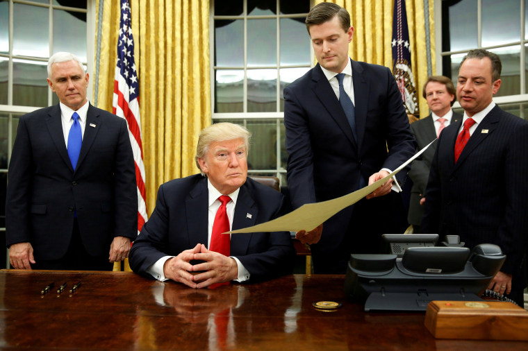 Image: FILE PHOTO: Porter hands document to Trump during signing ceremony in the Oval Office in Washington