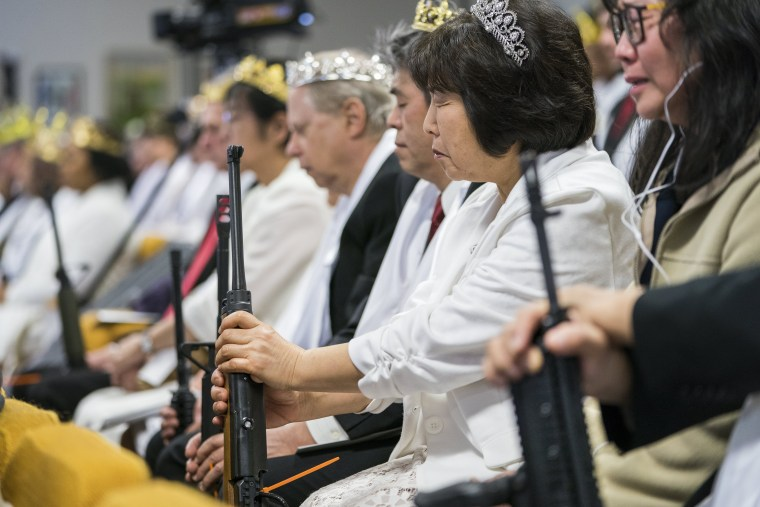 Parishioners with the Sanctuary Church hold onto their AR-15s, which churchgoers were encouraged to bring to a blessing ceremony to rededicate their marriages, at the World Peace and Unification Sanctuary in Newfoundland, Pennsylvania, USA, 28 February 20