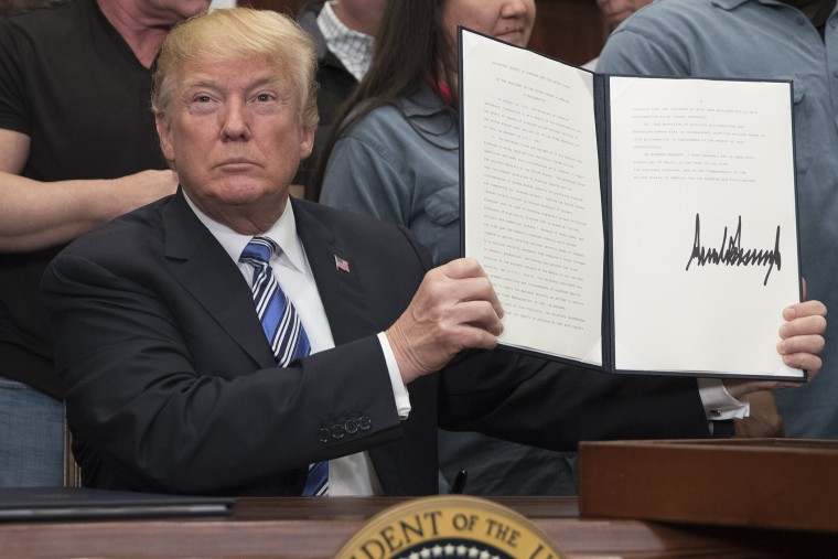 Image: US President Donald J. Trump signs a presidential proclamation on tariffs