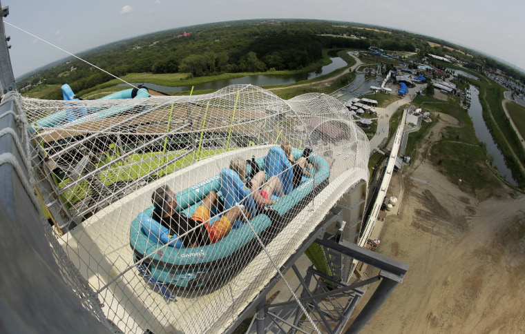 """In this July 9, 2014, file photo, riders go down the water slide called """"Verruckt"""" at Schlitterbahn Waterpark in Kansas City, Kan."""