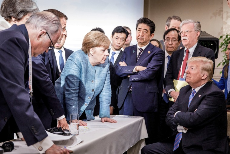 German Chancellor Angela Merkel speaks to U.S. President Donald Trump during the second day of the G7 meeting in Charlevoix city of La Malbaie, Quebec, Canada, June 9, 2018.