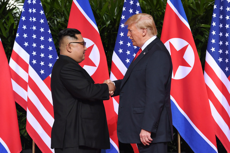 Image: North Korea's leader Kim Jong Un shakes hands with President Donald Trump