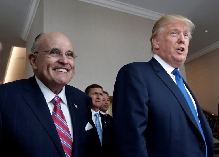 Image: FILE PHOTO: Donald Trump walks with former New York City Mayor Rudolph Giuliani through the new Trump International Hotel in Washington