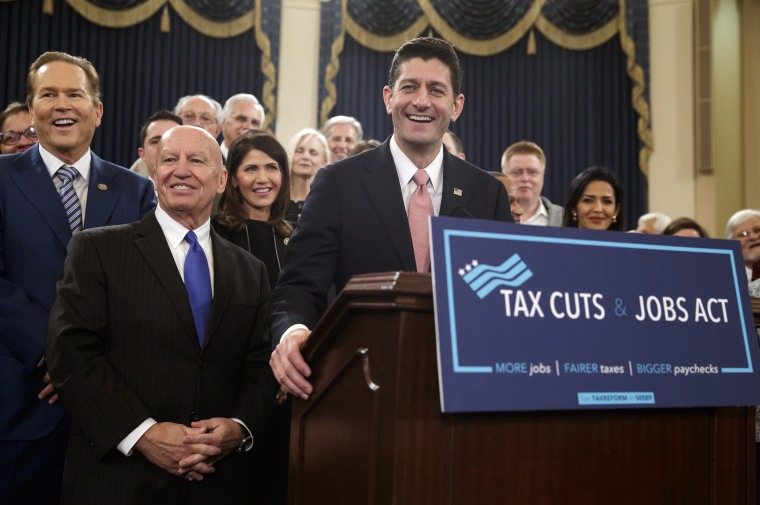 Speaker of the House Paul Ryan, R-Wis., joined by, from left, Rep. Vern Buchanan, R-Fla., House Ways and Means Committee Chairman Kevin Brady, R-Texas, and Rep. Kristi Noem, R-S.D., smiles as they unveil the GOP's tax overhaul, Nov. 2, 2017.