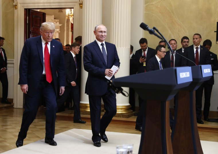 U.S. President Donald Trump, left, and Russian President Vladimir Putin arrive for a press conference after the meeting of U.S. President Donald Trump and Russian President Vladimir Putin at the Presidential Palace in Helsinki, Finland, Monday, July 16, 2