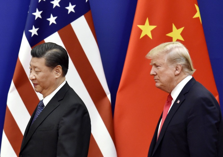 File photo taken in November 2017 shows U.S. President Donald Trump and Chinese President Xi Jinping at the Great Hall of the People in Beijing.