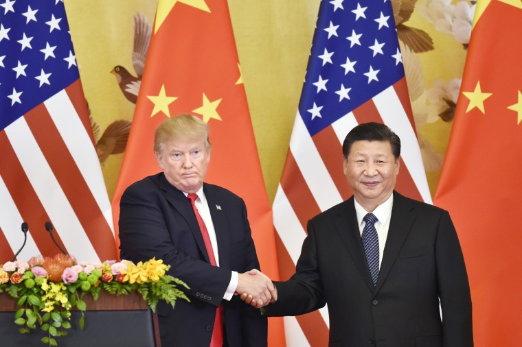 Photo shows U.S. President Donald Trump (L) and Chinese President Xi Jinping shaking hands during a joint press conference at the Great Hall of the People in Beijing in November 2017.