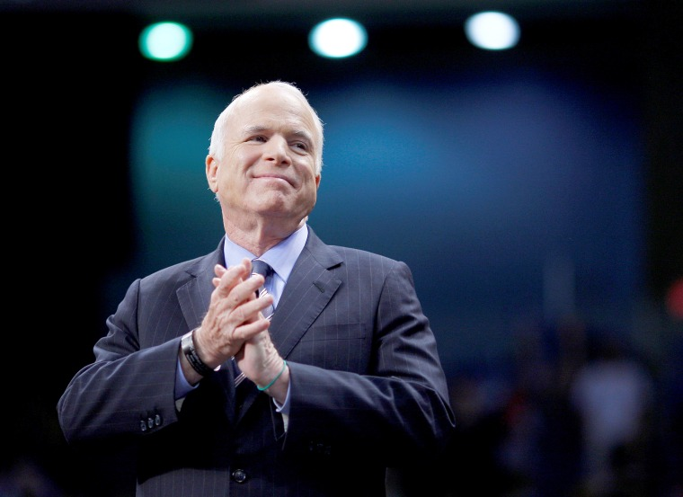 FILE PHOTO - U.S. Republican presidential nominee Senator John McCain listens as he is introduced at a campaign rally in Fayetteville