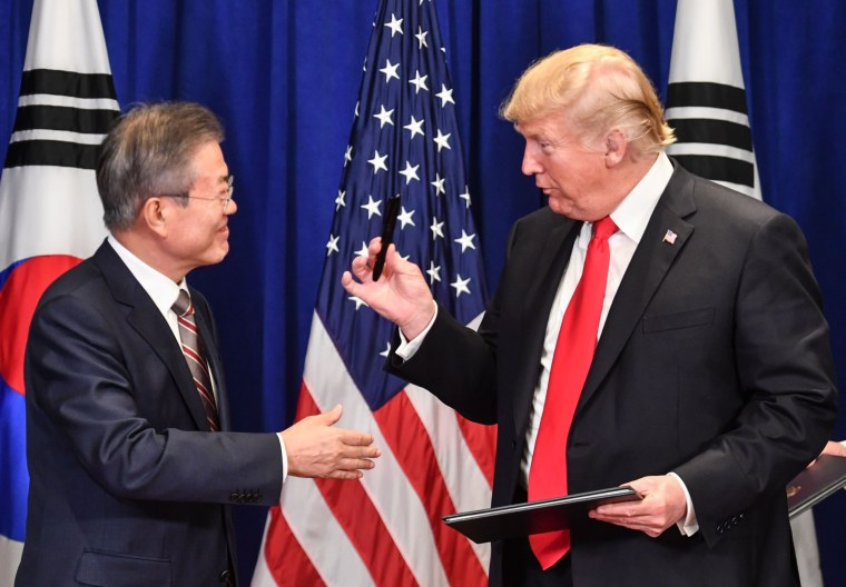 US President Donald Trump and South Korean President Moon Jae-in sign a trade agreement at a bilateral meeting in New York on September 24, 2018, a day before the start of the General Debate of the 73rd session of the General Assembly.