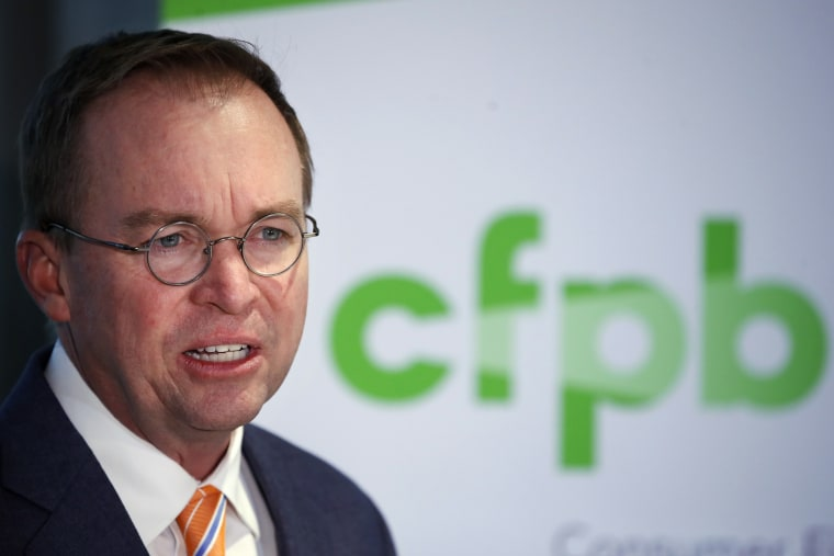 In this Nov. 27, 2017, file photo, Mick Mulvaney speaks during a news conference after his first day as acting director of the Consumer Financial Protection Bureau, or CFPB, in Washington.
