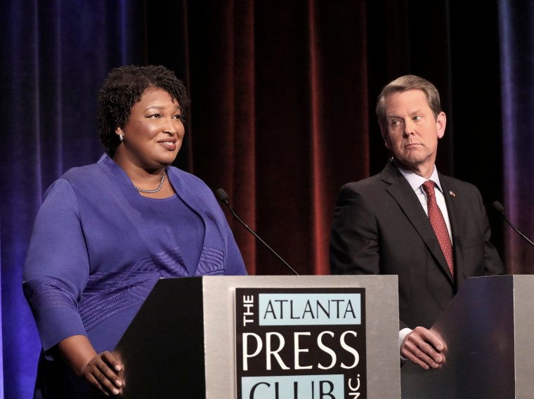 Democratic gubernatorial candidate for Georgia Stacey Abrams speaks as her Republican opponent Secretary of State Brian Kemp looks on during a debate in Atlanta, Georgia, October 23, 2018.