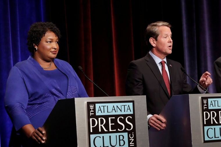 Republican gubernatorial candidate for Georgia Brian Kemp speaks as Democratic candidate Stacey Abrams looks on during a debate in Atlanta, Georgia, U.S, October 23, 2018. Picture taken on October 23, 2018.
