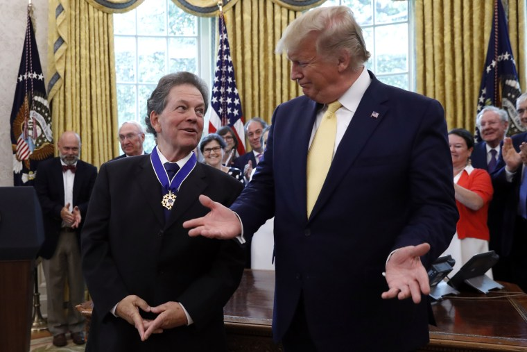 President Donald Trump talks with with economist Arthur Laffer after awarding him the Presidential Medal of Freedom Wednesday, June 19, 2019.