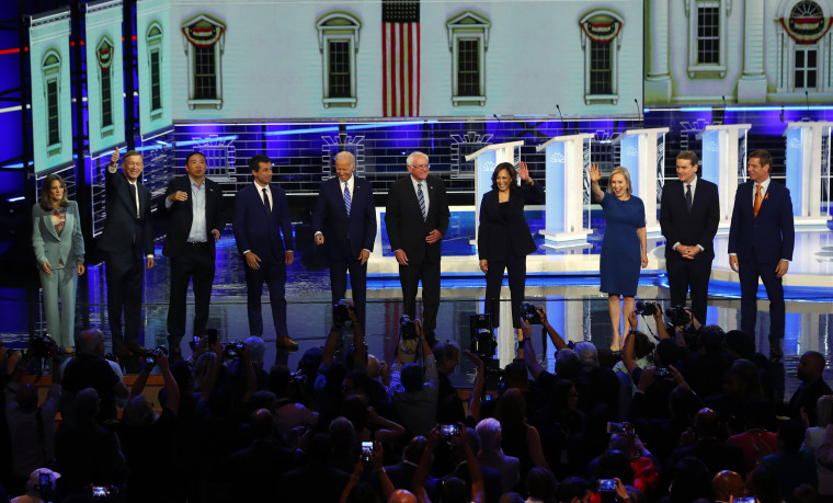 Democratic presidential candidates wave as they enter the stage for the second night of the Democratic primary debate hosted by NBC News at the Adrienne Arsht Center for the Performing Arts, Thursday, June 27, 2019, in Miami.